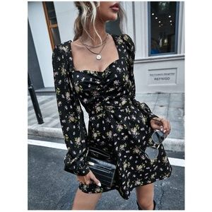 black floral print long sleeve mini dress. boho